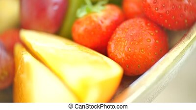 Close up of colorful fruit salad - background.