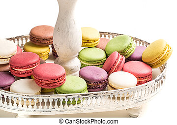 Fresh macaroons na plate on white background
