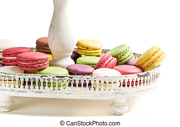 Colorful macaroons na plate on white background