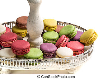 Stack of macaroons na plate on white background