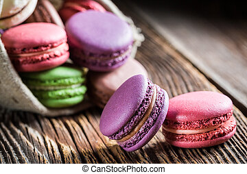 Sweet macaroons on wooden table