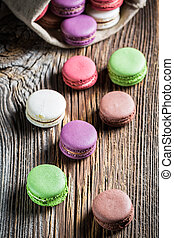 Delicious macaroons on wooden table