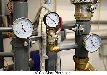Heating system. Close up of pipes with manometers