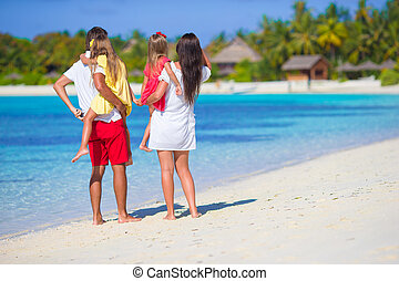 Family beach vacation - Happy beautiful family on a beach...