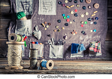 Background made of needles, threads and buttons in tailor...
