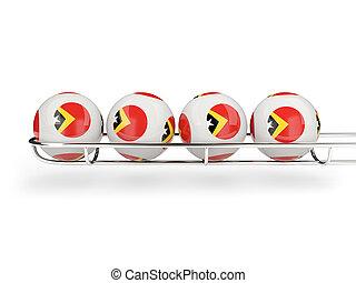 Flag of east timor on lottery balls 3D illustration