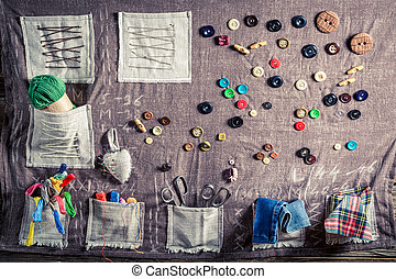 Background made of threads, needles and buttons in tailor...