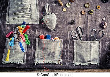Handmade sewing cloth made of buttons, needles and threads...