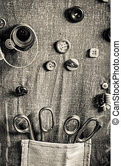 Vintage background made of buttons, needles and threads in...