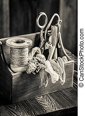 Needle, threads and scissors in tailor workshop