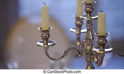 Silver classic candlestick with white candle
