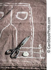 Tailor pattern trousers with cloth and scissors