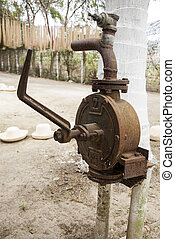 Old fashioned water pump - An old hand water pump in Manta -...