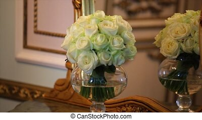 bouquet with white roses and grenn carnation in the glass vase