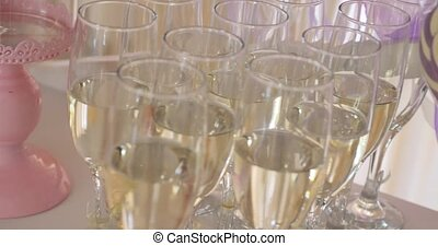 Tall glasses with sparkling wine