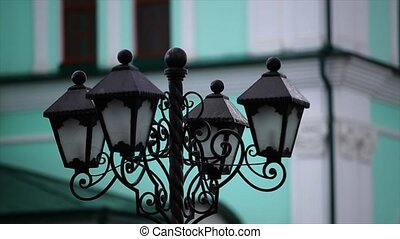 Vintage street lamp green background.