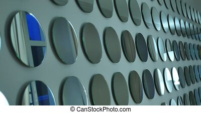 wall with many round mirrors.
