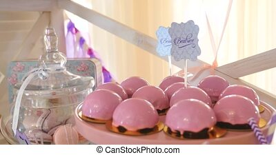 Pink cake pops on a dessert table at party or wedding...