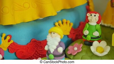 Handmade modeling clay figure with sweets.