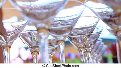 Empty martini glasses on a black.