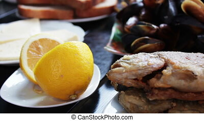 Seafood Mussels and Fish Trout on a Plate in a Restaurant...