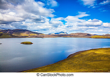 Cool lake among the yellow tundra - Cool blue water of the...