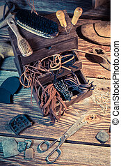 Shoemaker workplace with tools, leather and shoes