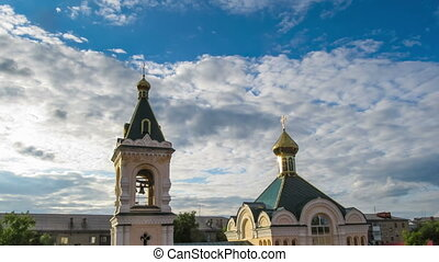 Church with Gold Domes Against the Sky and Moving Clouds