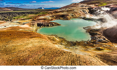 Blue pond and volcanic mountain, Iceland