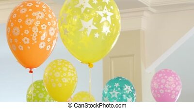 Children's room decorated with balloons ready for the holiday, nobody.