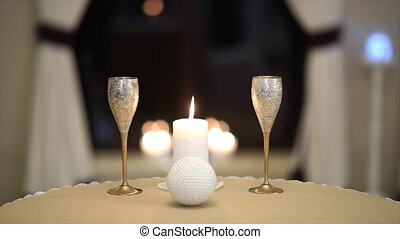 table for two setup with glasses and candle.