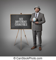 See different countries text on blackboard with businessman...