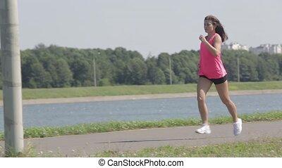 Pretty girl runs near the Lake HD