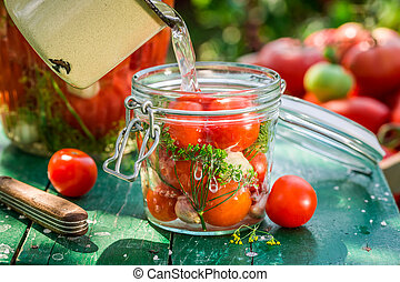 Pickled tomatoes with home grown ingredients