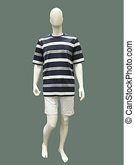 Male mannequin in summer clothes isolated on green...