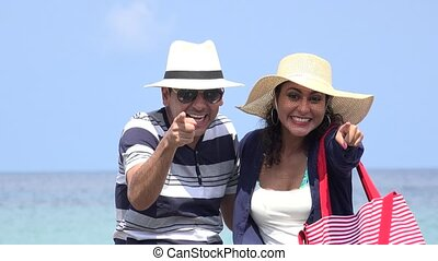 Happy Male And Female Tourists On Summer Vacation