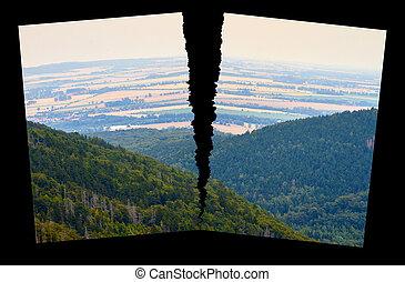 landscape - Image of a landscape with split against black...