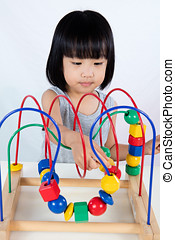 Asian Little Chinese Girl Playing Colorful Educational Toy