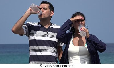 People Drinking Cold Water On Hot Summer Day