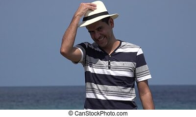 Happy Male Tourist With Hat Waving On Summer Holiday