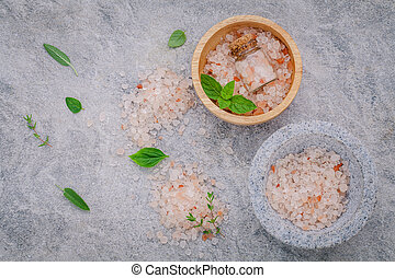 Himalayan pink salt in wooden bowl with peppermint...