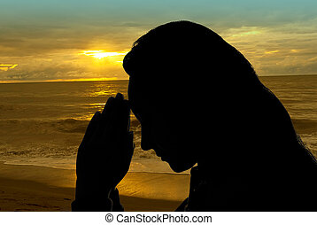 Woman praying outdoors - Woman hands praying outdoors in a...