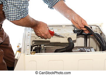 repair clothes washer - man is fixing a problem on a clothes...