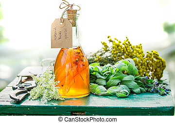 Homemade tincture with alcohol and honey in garden