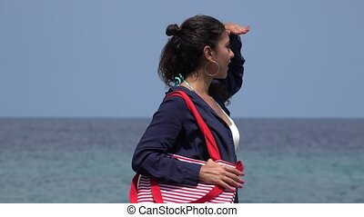 Tourist Woman Looking At Ocean