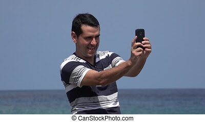 Goofy Tourist Man Taking Selfies And Having Fun