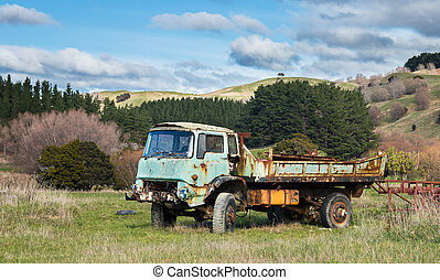 Old Farm Truck - One very old and dead truck parked in a...