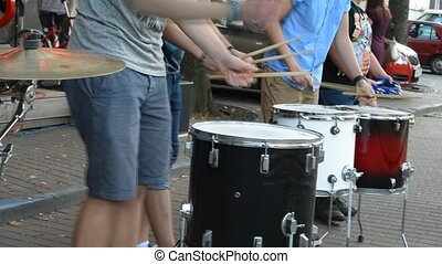 Young men plays drums. Close up