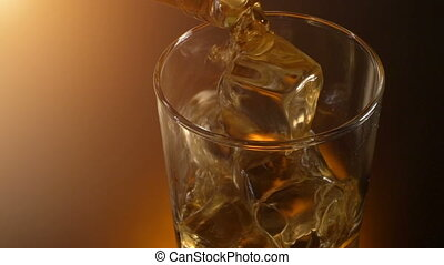 barman pouring whiskey in the glass with reflection , warm...