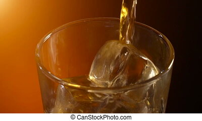 Pouring a scotch whiskey on the rocks, warm evening...